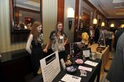 "Team members from Charlotte Radiology at their exhibit table.To obtain digital files or prints for your own use, send an email to nancy@nancypiercephoto.com with ""Fast 50"" in the subject line."