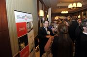"Event Partner Phase 3 Media representative Jim Cannata talks with attendees during the networking hour.To obtain digital files or prints for your own use, send an email to nancy@nancypiercephoto.com with ""Fast 50"" in the subject line."