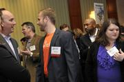 "AccruePartners representative Matt Donato (center) talks with attendees prior to the awards program.To obtain digital files or prints for your own use, send an email to nancy@nancypiercephoto.com with ""Fast 50"" in the subject line."