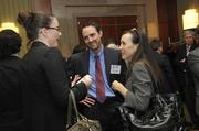 "Brady Teague and Carrie Quinlan, both with Talent Bridge, talk with Lindsay Ford (left) of CliftonLarsonAllen.To obtain digital files or prints for your own use, send an email to nancy@nancypiercephoto.com with ""Fast 50"" in the subject line."