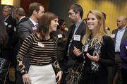 "Charlotte Business Journal audience development representative Catherine Burton (left) talks with Fast 50 attendee Claire Burke of the Carolina Panthers.To obtain digital files or prints for your own use, send an email to nancy@nancypiercephoto.com with ""Fast 50"" in the subject line."
