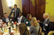 "Attendees at the table for Business Wise, an associate sponsor of the event, before the start of the lunch program.To obtain digital files or prints for your own use, send an email to nancy@nancypiercephoto.com with ""Fast 50"" in the subject line."