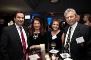 List-maker Lou Moushakos of LM Restaurants, right, with his wife, Joy, second from the right