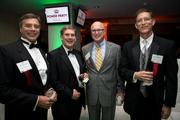 From left to right: Dennis Eaton of Colliers International, Frank Baird of Capital Associates, list-maker Harvey Schmidt of the Greater Raleigh Chamber of Commerce, and Jim Anthony of Colliers International