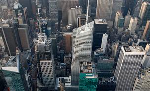 One Bryant Park, home to the offices of Bank of America Corp., center right, and the Conde Nast Building at 4 Times Square, center left, stands in Manhattan in this aerial photo taken over New York.