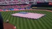 A flag is displayed on the field for pre-game festivities.
