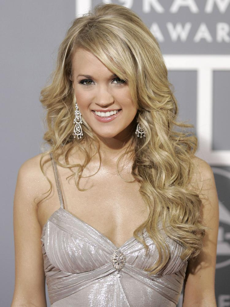 "Underwood was the winner of the fourth season of ""American Idol"" in 2005, launching the Oklahoma native's career into superstardom. She has sold more than 15 million albums world-wide, has 18 #1 singles and won six Grammy Awards. Photographer: Francis Specker/Bloomberg News"