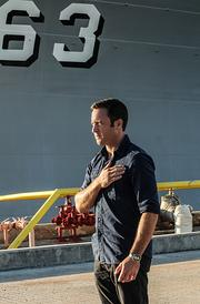 "Actor Alex O'Loughlin, left, who plays Steve McGarrett on ""Hawaii Five-0,"" i in a scene from the Dec. 13 episode of the show filmed at the Battleship Missouri Memorial at Pearl Harbor."