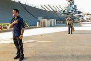 "Actor Alex O'Loughlin, left, who plays Steve McGarrett on ""Hawaii Five-0,"" is seen with guest star James Saito in a scene from the Dec. 13 episode of the show filmed at the Battleship Missouri Memorial at Pearl Harbor."