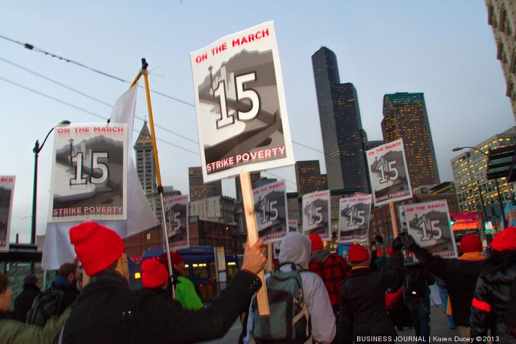 Advocates for the SeaTac minimum wage increase marched to downtown Seattle in December to support the new minimum wage law.
