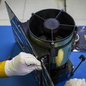 Planetary Resources engineers are assembling the company's first satellite, for launch in 2014.
