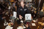 Milwaukee Wave coach Keith Tozer served drinks to guests.