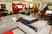 Gabe Winslow, a partner in Sq1's Portland office, relaxes in one fo the company's informal gathering spaces.