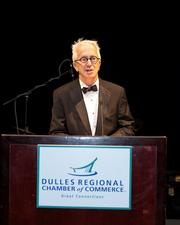 """The Dulles Regional Chamber of Commerce raised more than $20,000 for the USO of Metropolitan Washington at its """"Stars Over Dulles"""" gala, which recognized the best businesses in the region. Washington Business Journal Publisher Alex Orfinger spoke at the event."""