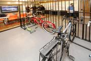 The jail-themed bike parking at Sq1's Portland office honors the history of the Police Headquarters building.