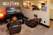 Sq1 employees take a break in a gaming lounge.