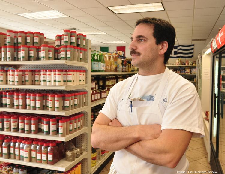 Benny Anastasio, owner of Pellegrino Importing Co., is aiming to open his Malta location by mid-May. It will be his third store. He appears here in the Albany store.