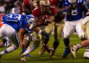 Florida State tailback Devonta Freeman plows through Duke defenders on his way to the end zone and a touchdown.