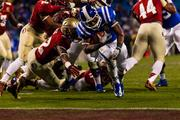 Duke running back Josh Snead dives into end zone for his team's only score. The top-ranked Seminoles beat the Blue Devils 45-7.