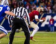 Florida State quarterback Jameis Winston rushes for some of his 68 yards on the ground in his tuneup for the national chamionship game.