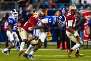 Duke receiver Isaac Blakeney gets tackled after making a catch.