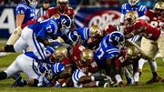 A mass of players from both sides end up in the pile after this running attempt by Duke.