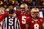 Florida State quarterback Jameis Winston is congratulated by teammates after scoring a touchdown. The top-ranked Seminoles beat the Duke Blue Devils 45-7 in the Dr Pepper ACC Football Championship Game on Dec. 7, 2013 at Bank of America Stadium in Charlotte.