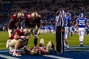 Teammates hover over Florida State tight end Nick O'Leary after he was injured on a catch attempt. Duke was penalized for its hit on the play.