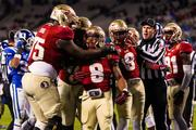 Florida State's Devonta Freeman is swarmed by teammates after scoring a touchdown.