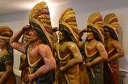 Cigar-store Indians being auctioned at the Hilltop on Saturday.