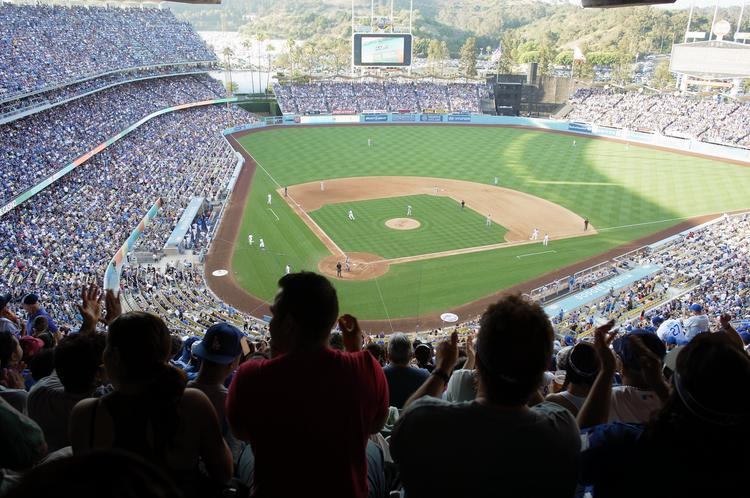 A large crowd enjoys a game at Dodger Stadium.