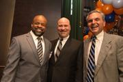 Kenneth Banks, CEO of Banks Contracting; BBJ Publisher John Dinkel and Paul Tiburzi, managing partner of DLA Piper's Baltimore office, network at the 40 under 40 event.