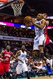Charlotte Bobcats forward Gerald Henderson takes it to the hoop against the Philadelphia 76ers.