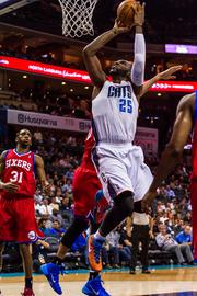 Charlotte Bobcats center Al Jefferson takes it to the hoop against the Philadelphia 76ers.