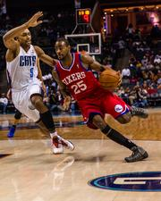 Philadelphia 76ers guard Elliot Williams guard looks for a path to the basket as Charlotte Bobcats guard Gerald Henderson defends.