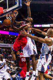Philadelphia 76ers guard Elliot Williams gets fouled driving to the hoop.
