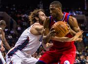 Philadelphia 76ers forward Thaddeus Young gets his personal space invaded by Charlotte Bobcats defender Josh McRoberts.