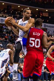 Charlotte Bobcats forward Jeffery Taylor comes down with a rebound over Philadelphia 76ers forward Lavoy Allen.