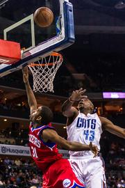 Philadelphia 76ers guard Hollis Thompson takes a driving shot as Charlotte Bobcats forward Anthony Tolliver defends.