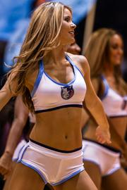 A Charlotte Bobcats Lady Cats cheerleader performs for the crowd.