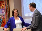 Wendy Terry of Withum Smith Brown PC shares a laugh with Clay Worden of McGladrey.