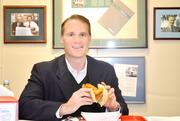 Jack Glover of Incline Equity Partners in Pittsburgh with his fish sandwich.