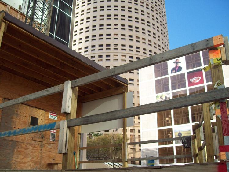 The corner entrance to Aloft, visible behind the wood scaffolding.