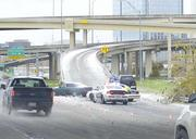 Highway fly-overs remained closed in downtown on Friday until crews could sand them.