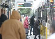 Downtown commuters board DART trains instead of their cars on Monday morning.