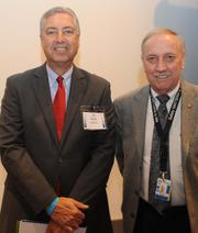 Louis Miller, right, with Richard Pelc of Southwest Airlines at the South Metro Development Outlook on Feb. 9, 2012.