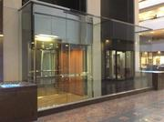 The elevators in the lobby of Two Pershing Square are glass, providing a view of the atrium.