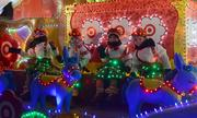 Chilly children ride on a Target-sponsored Holidazzle float.