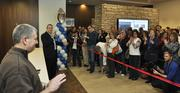 IMA moves into its new building at 1705 17th with a ribbon cutting. Rob Cohen, left and Bob Reiter speak to the 200-plus employees.