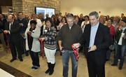 Bob Reiter (far right), president, and CEO Rob Cohen (second from right), along with IMA colleagues cut the ribbon in their new space at 1705 17th St.